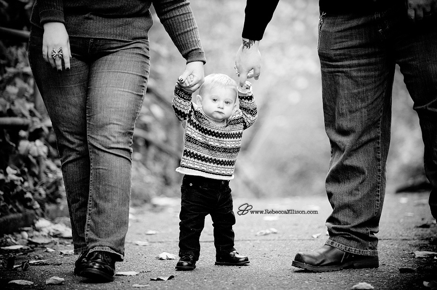 young toddler walking with parents