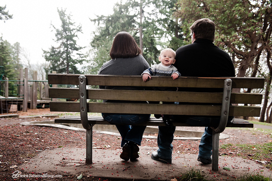baby boy on bench with parents
