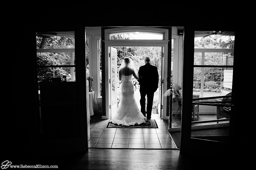 Bride gets ready to walk down the aisle in a black and white portrait at the MonteVilla Farmhouse in Bothell, WA