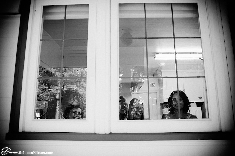 Bridal party looks out the window at the Montevilla farmhouse photographed by Rebecca Ellison Photography