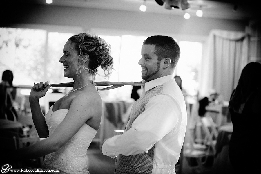 Black and white wedding reception photo of a bride and groom photographed by Seattle wedding photographer Rebecca Ellison