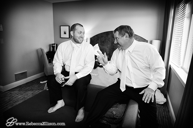 groom and dad relaxing and talking football before wedding