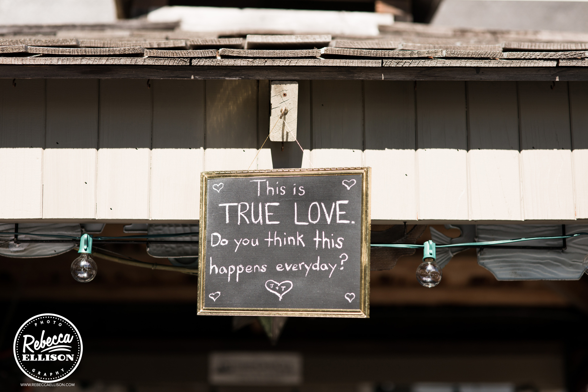 chalkboard decor details at backyard beach house wedding photographed by Seattle wedding photographer Rebecca Ellison
