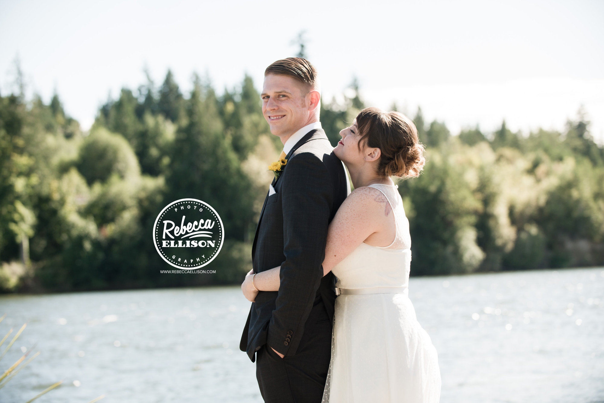Bride and groom on the beach at a backyard beach house wedding near Seattle photographed by Rebecca Ellison Photography