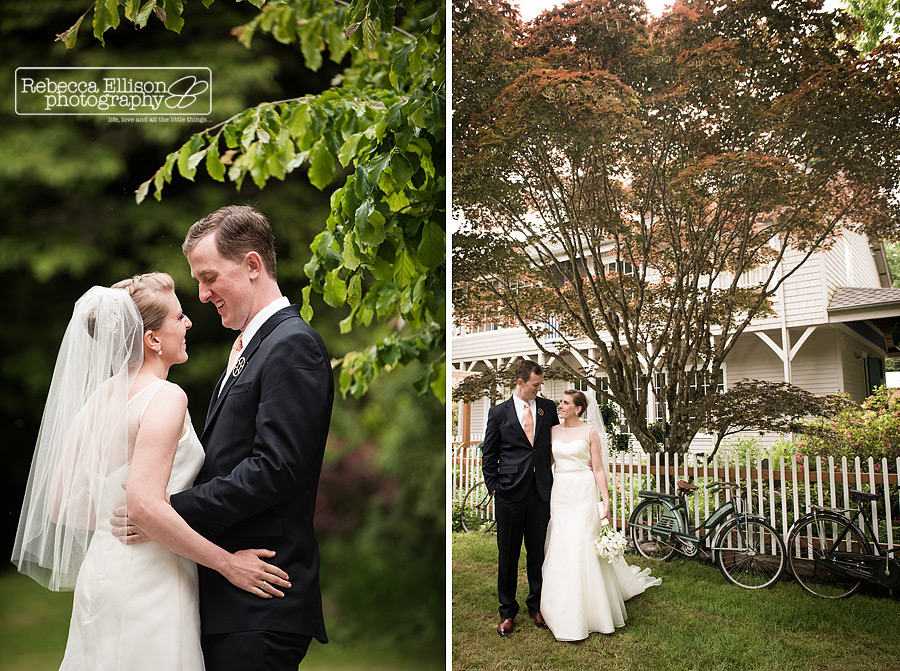 bridal portraits of couple standing in front of white picket fence and an old vintage bike