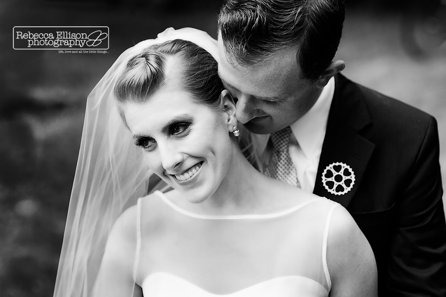 groom whispers into brides ear as she laughs during their vashon Island backyard wedding by Seattle Wedding Photographer Rebecca Ellison Photography
