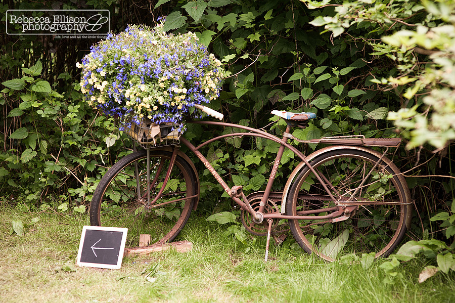 vintage bicycle with flowers on top at backyard wedding