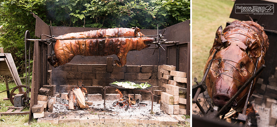 pig roasting on a spit during backyard wedding reception on Vashon Island by Rebecca Ellison Photography