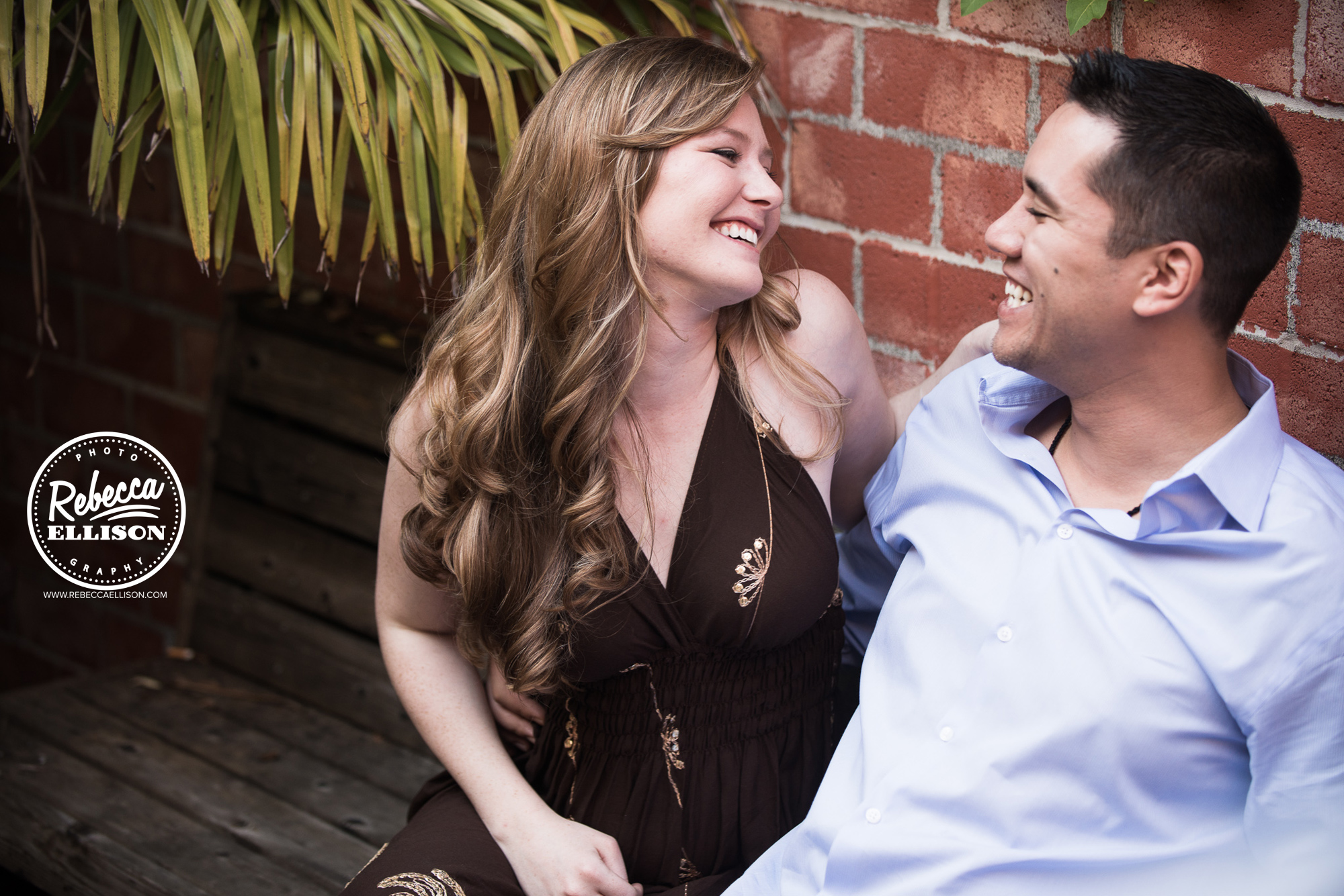 A happy couple during their engagement portrait session photographed by Ballard Engagement Photographer Rebecca Ellison