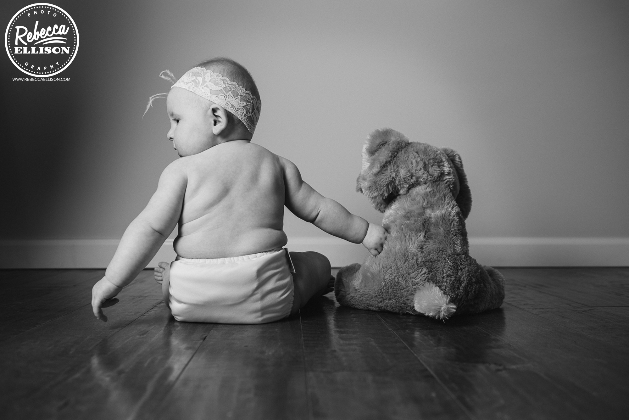 Baby and teddy bear at a lifestyle photography session photographed by bellevue baby photographer Rebecca Ellison