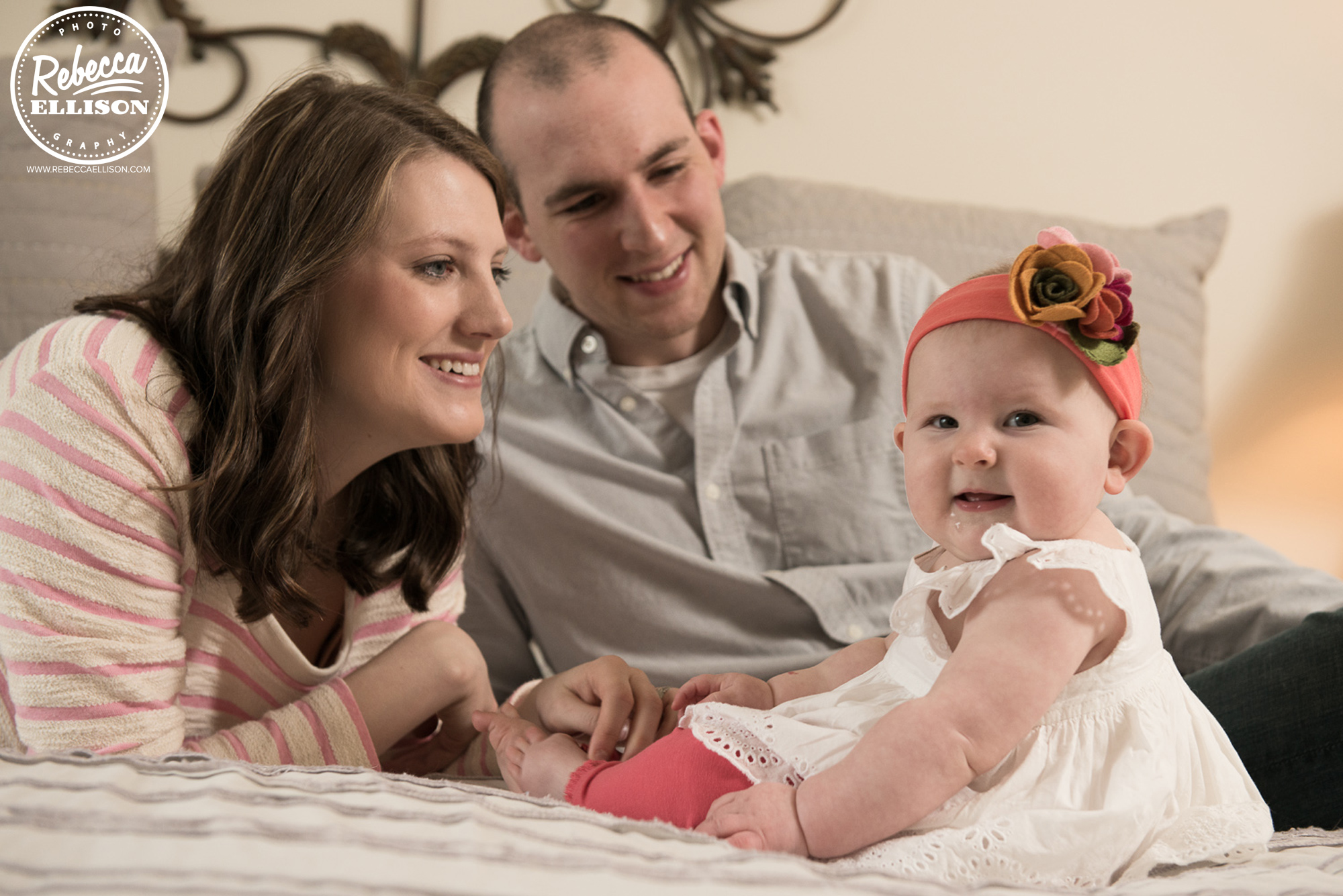 Mom and dad and baby relax during an in home portrait session photographed by Rebecca Ellison Photography