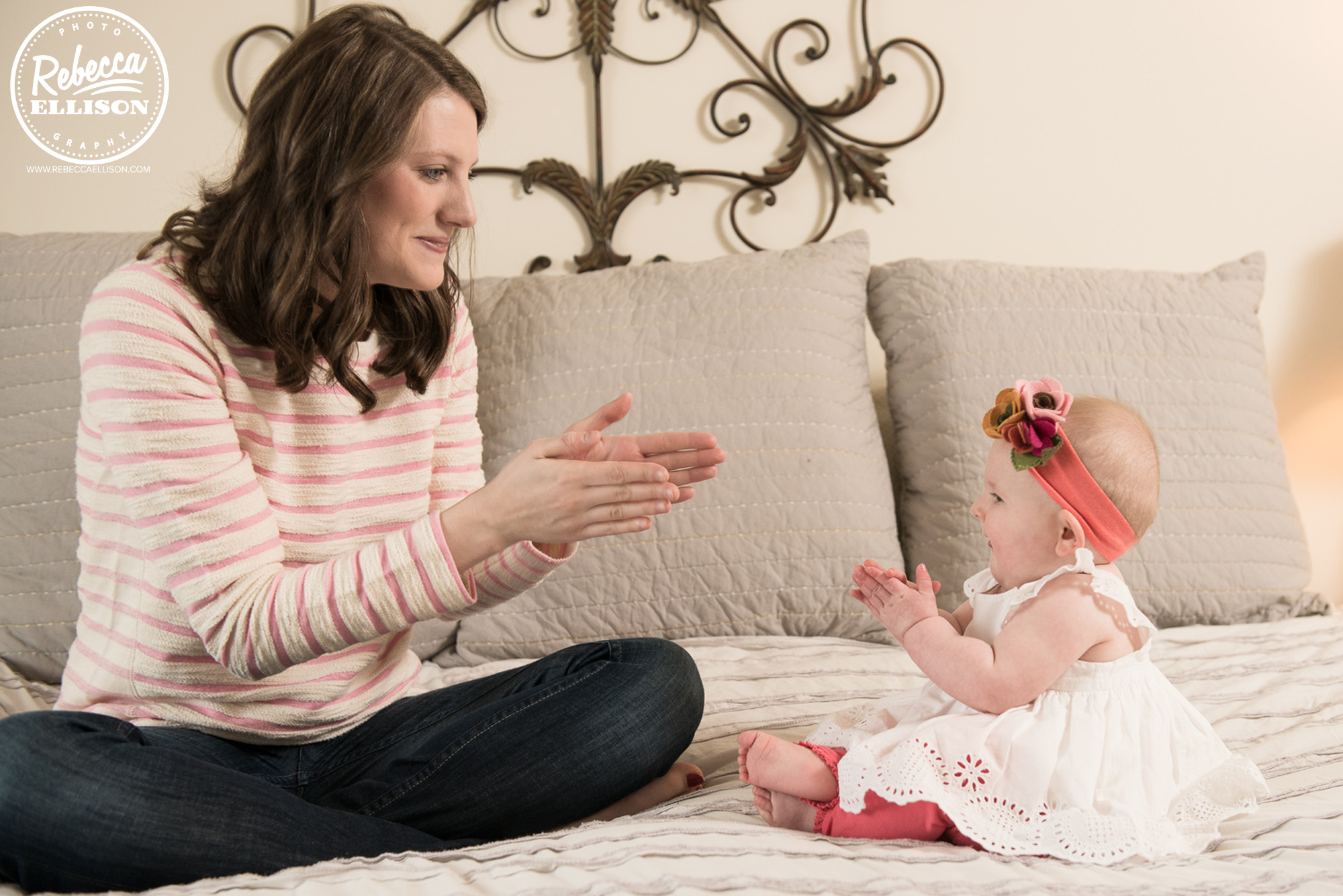 Mom and Baby clap hands at a lifestyle photography session in Bellevue photographed by Rebecca Ellison Photography