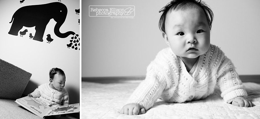 A baby poses with a book and elephant wall decor during a child portraits session photographed by Rebecca Ellison Photography