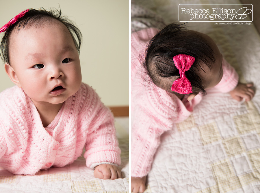 6 month old baby girl in a pink crocheted sweater during a child portraits session photographed by Seattle baby photographer Rebecca Ellison