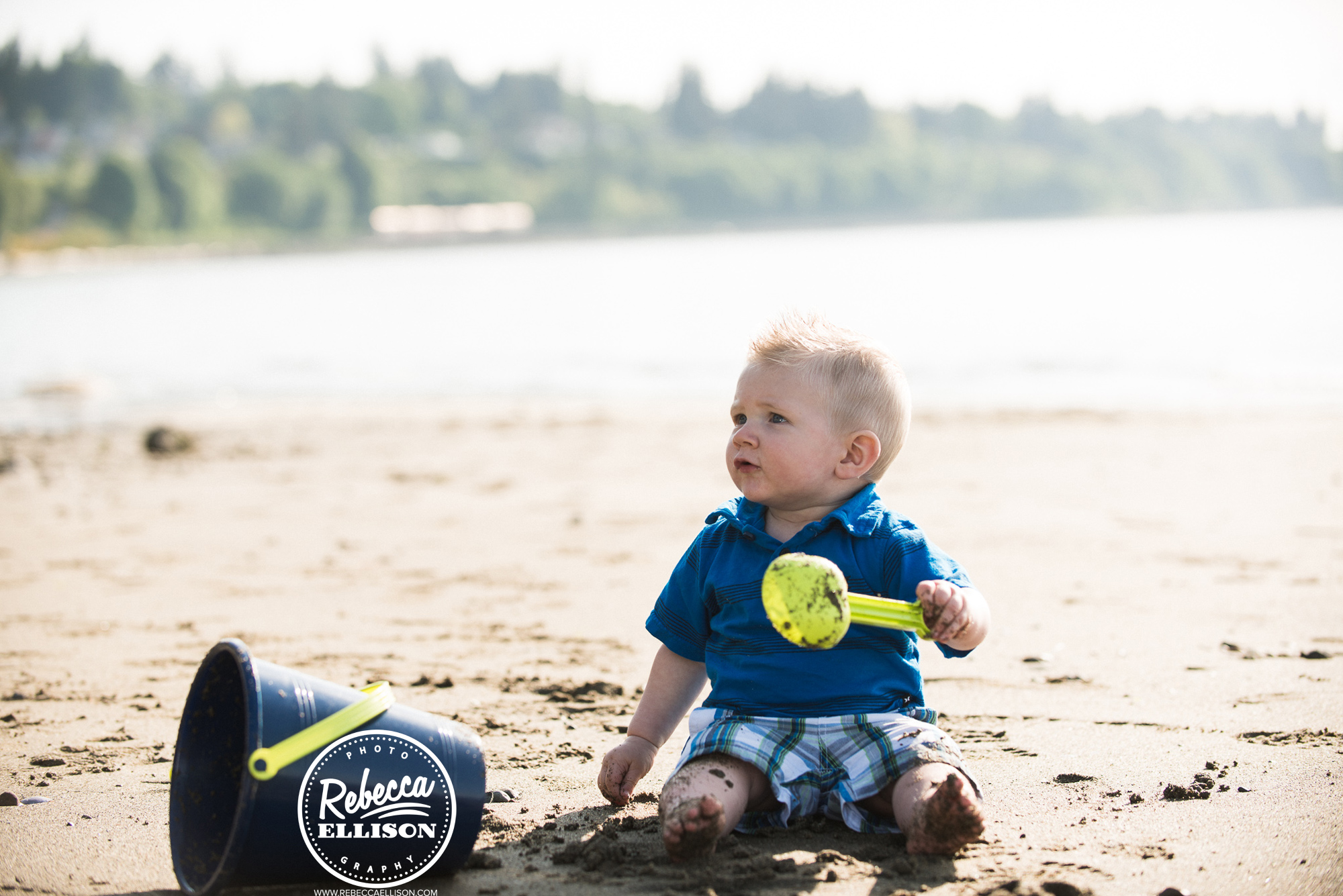 Playing in the sand at the beach photographed by Everett Family photographer Rebecca Ellison