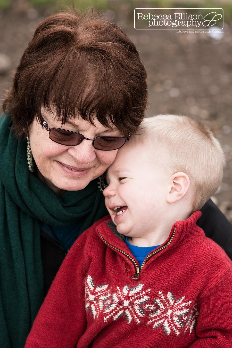 grandma snuggles young grandson