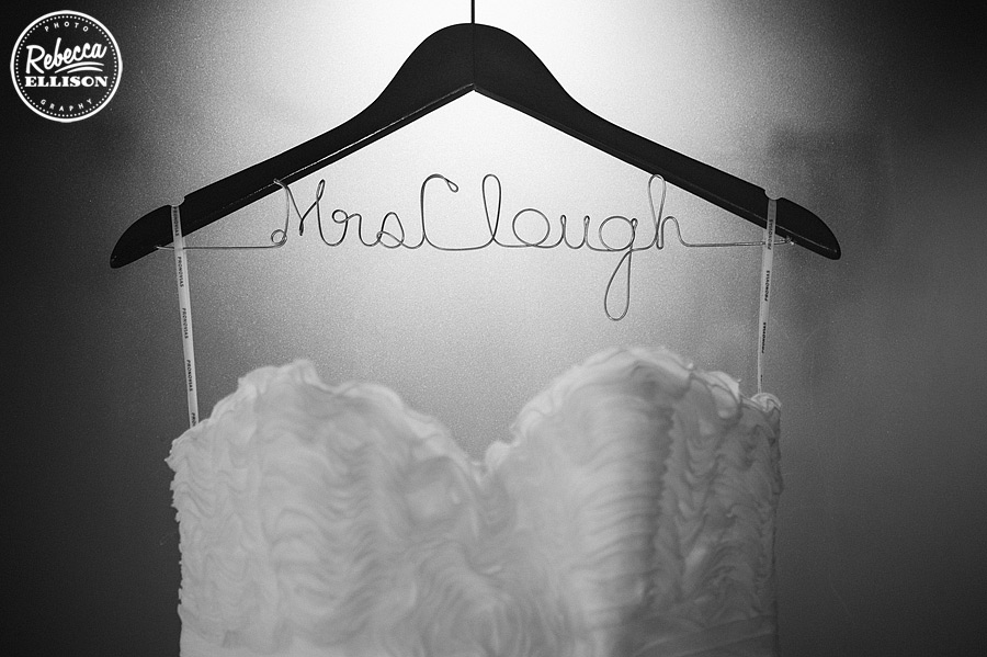 Personalized hanger for ruffled wedding gown add elegant detail to a black, white and red wedding