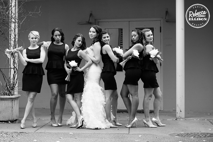 bride and bridesmaids at an elegant black, white and red wedding featuring a strapless ruffled wedding dress and black bridesmaid's dresses photographed by rebecca ellison photography