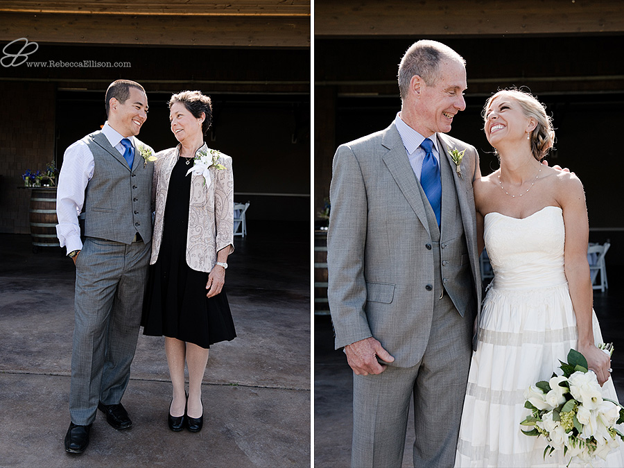 Snohomish wedding photographer Rebecca Ellison captures candid moment of groom with his mom and bride with her dad during family wedding portraits at outdoor wedding venue Hidden Meadows