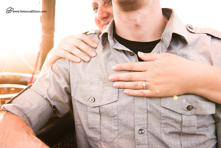detail of ring on woman's hand after her surprise proposal in a hot air balloon photographed by Seattle Wedding photographer Rebecca Ellison