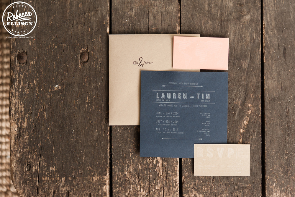 Black wedding invitations against a wooden background photographed by Seattle wedding photographer Rebecca Ellison