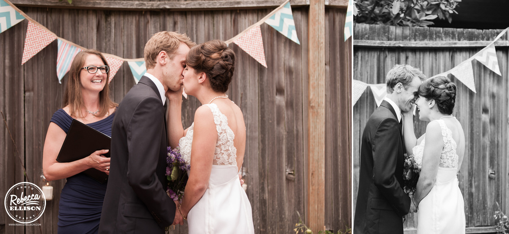 A bride and groom kiss during their intimate backyard wedding ceremony photographed by Rebecca Ellison photography
