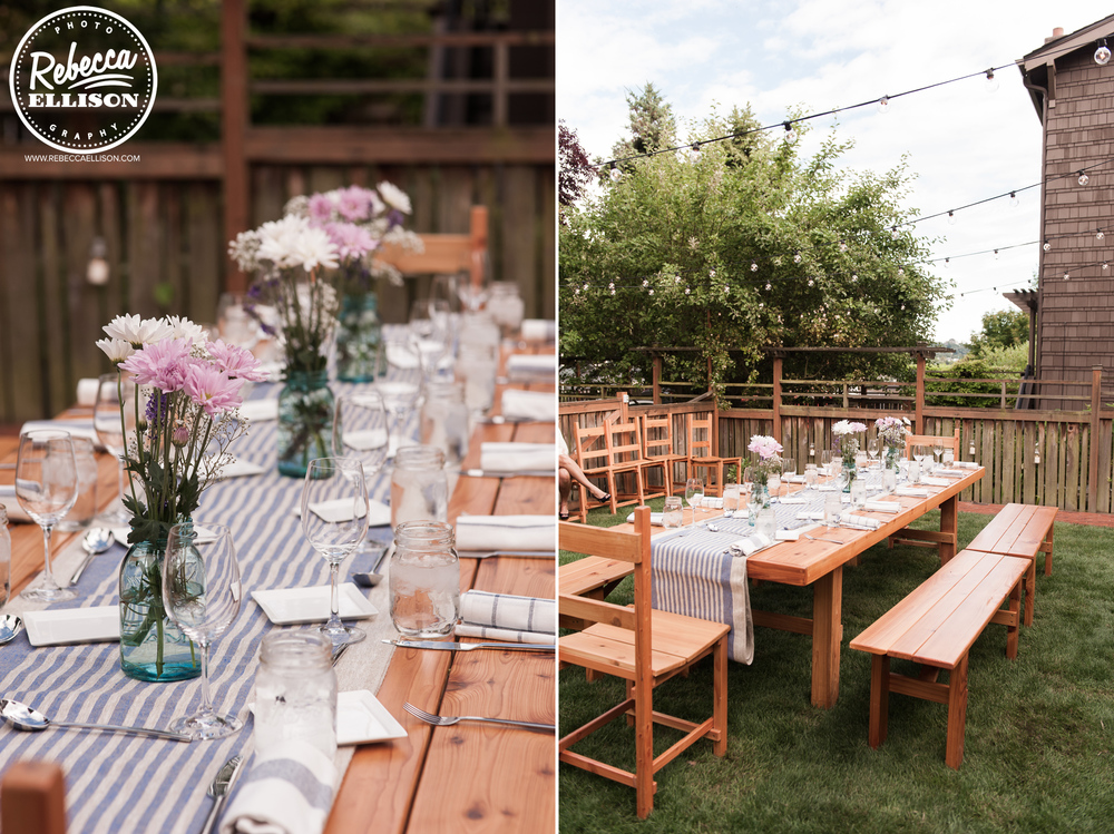 The table is set at an intimate backyard wedding featuring blue and white table runners and lavender and white flowers photographed by Rebecca Ellison Photography