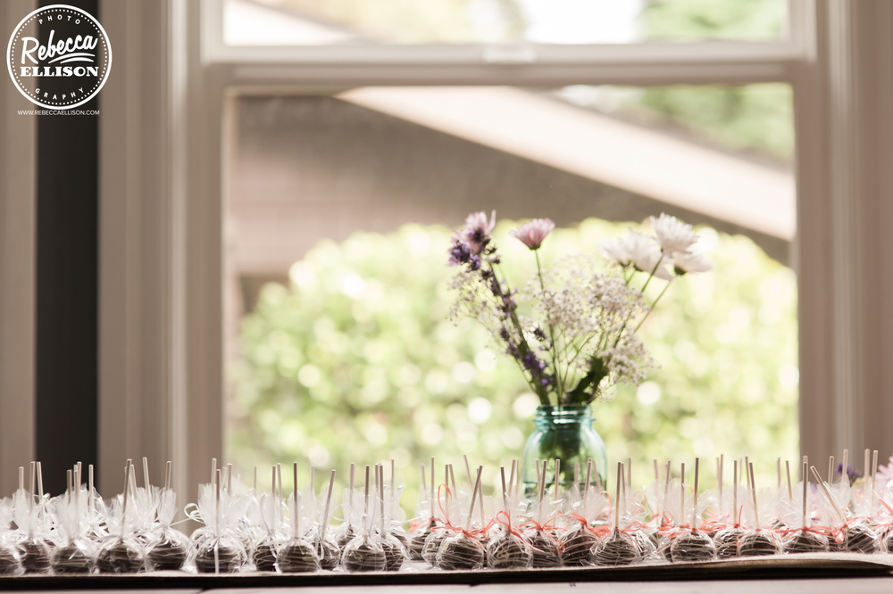Cocktail glasses lined up against a window at an intimate backyard wedding photographed by Seattle wedding photographer Rebecca Ellison