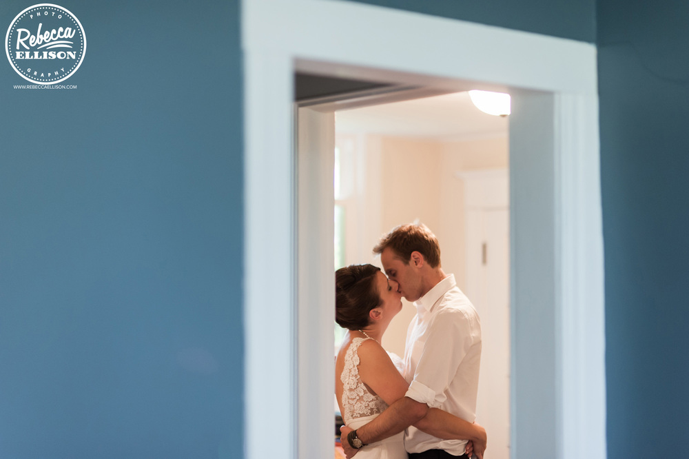 Bride and groom share a private moment on their wedding day photographed by Seattle wedding photographer Rebecca Ellison