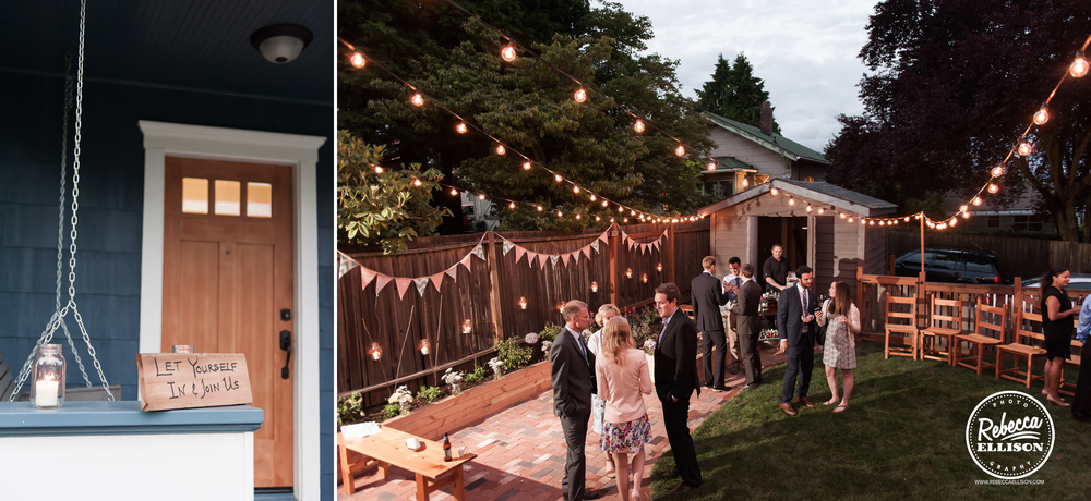 Evening falls and the lights come on at an intimate backyard wedding in Seattle featuring penant banners and wooden benches photographed by Rebecca Ellison photography
