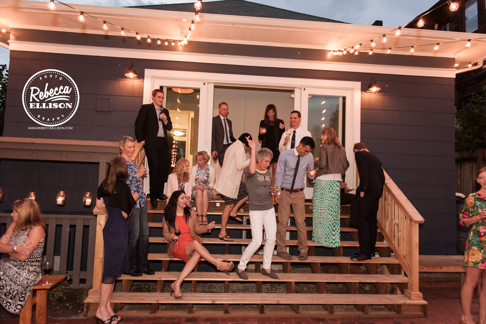 Wedding guests enjoy the reception at an intimate backyard wedding in Seattle photographed by Rebecca Ellison photography