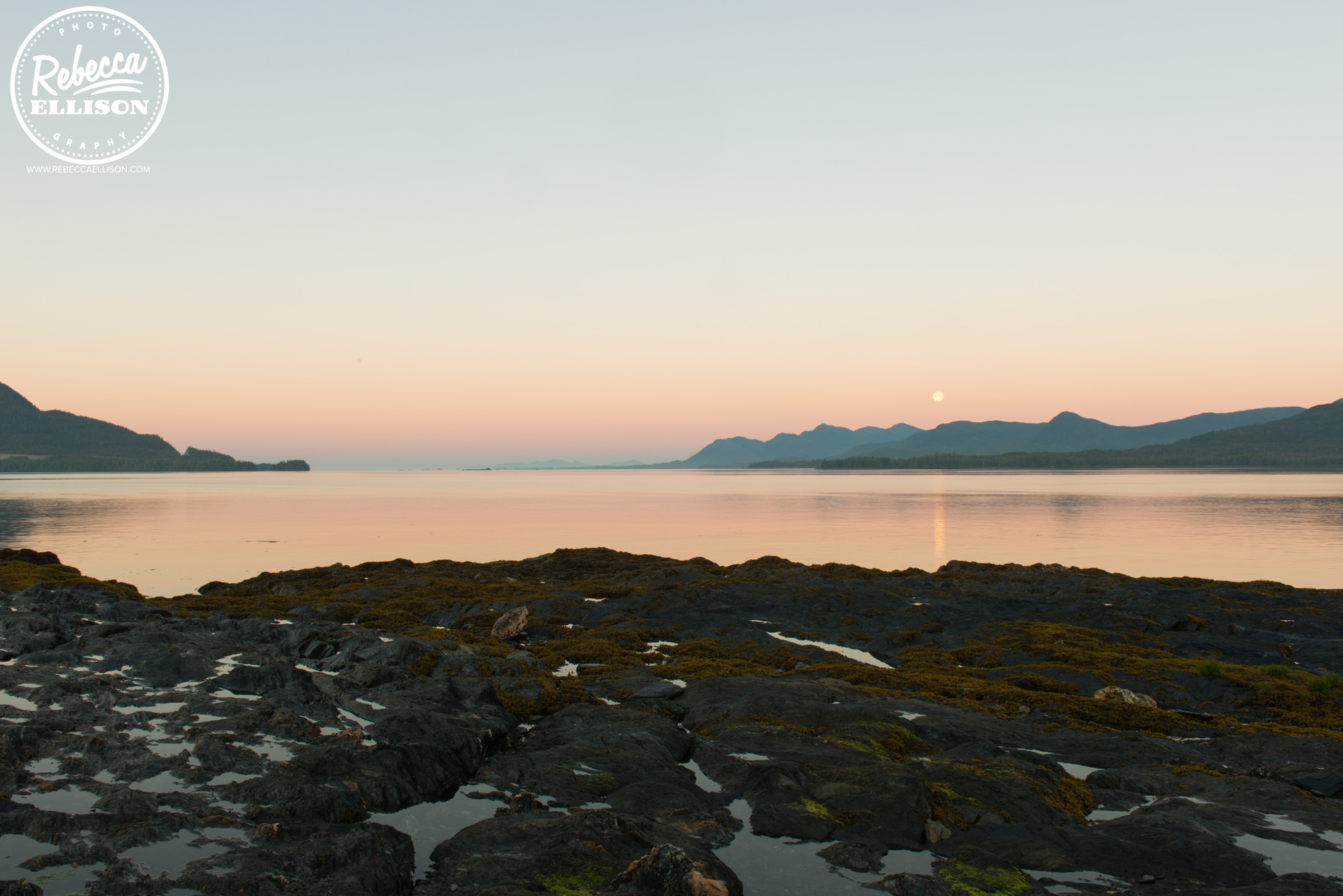 Sunrise in Ketchikan Alaska looking out over a rocky beach photography by Rebecca Ellison