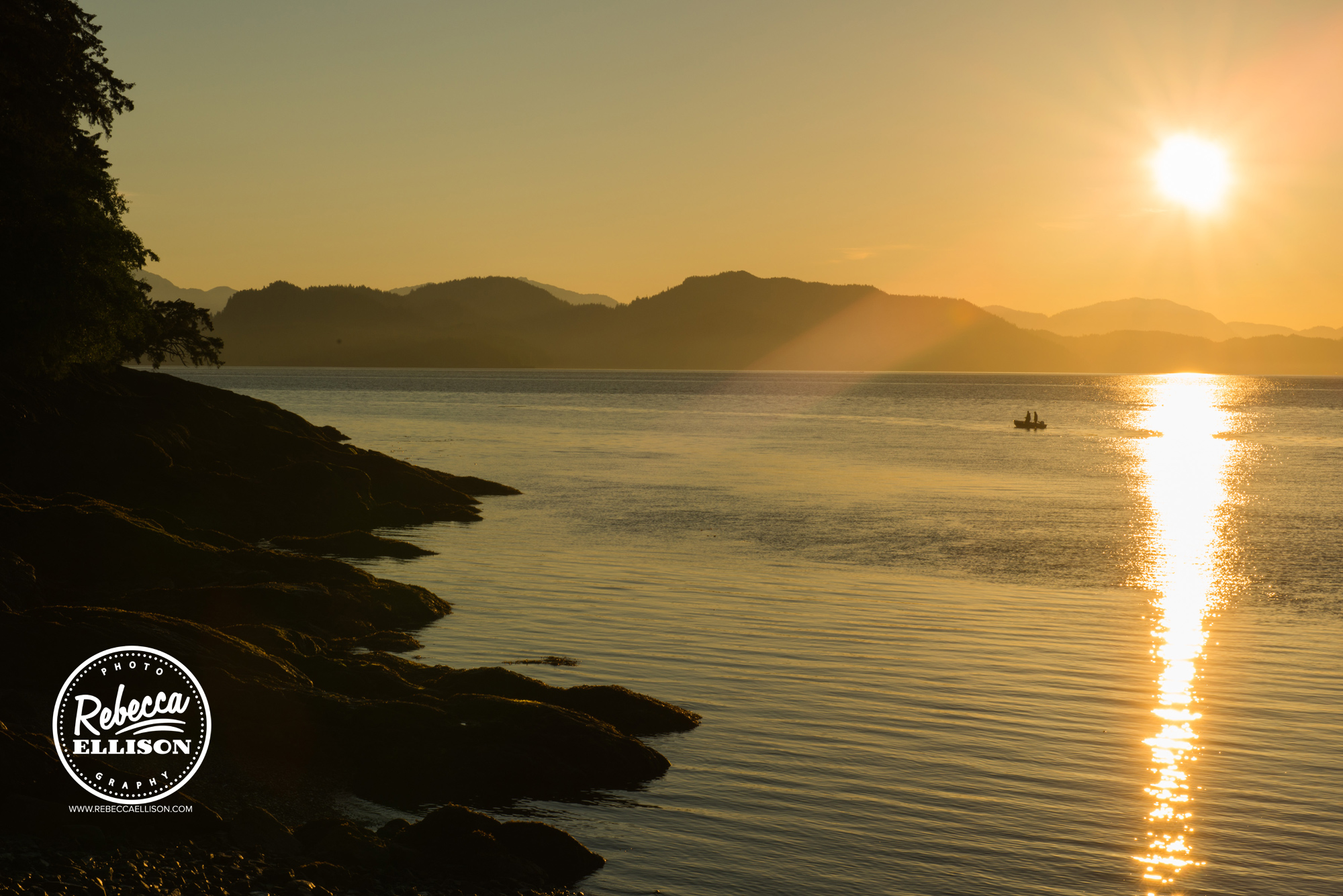 Ketchikan Sunrise over the cean and rocky beach photographed by Rebecca Ellison Photography