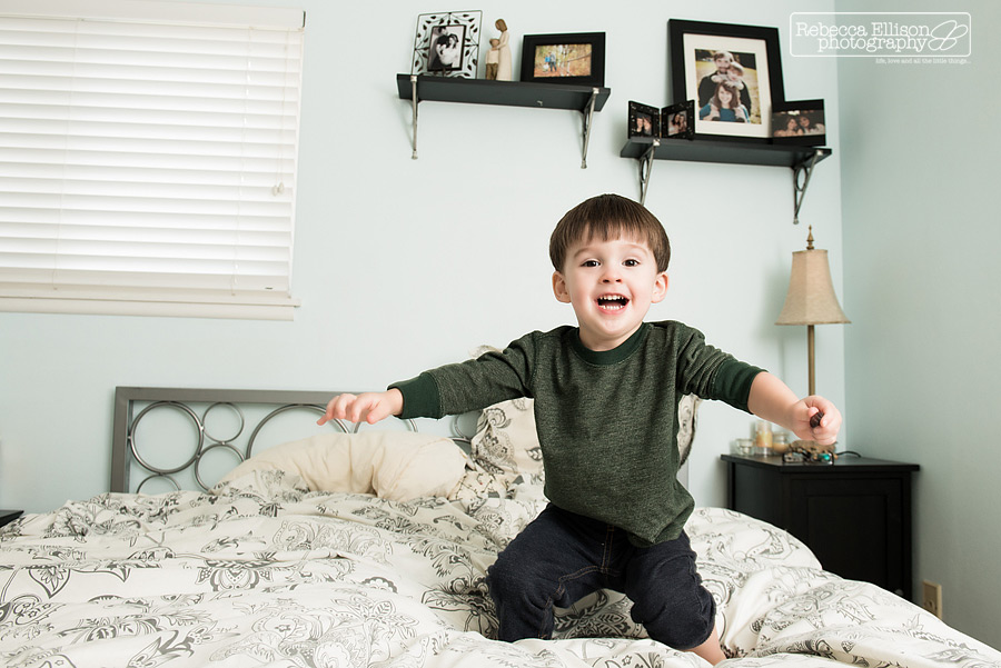 Two year old boy jumps on the bed photographed by Seattle child photographer Rebecca Ellison