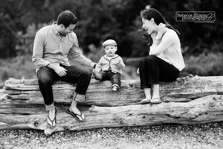 A boy and his family play at the beach during Carkeek Park family portraits photographed by Rebecca Ellison Photography