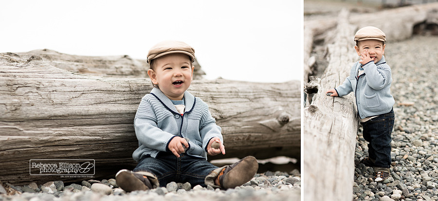 One year old boy plays with driftwood at the beach during his first year photos from Rebecca Ellison Photography