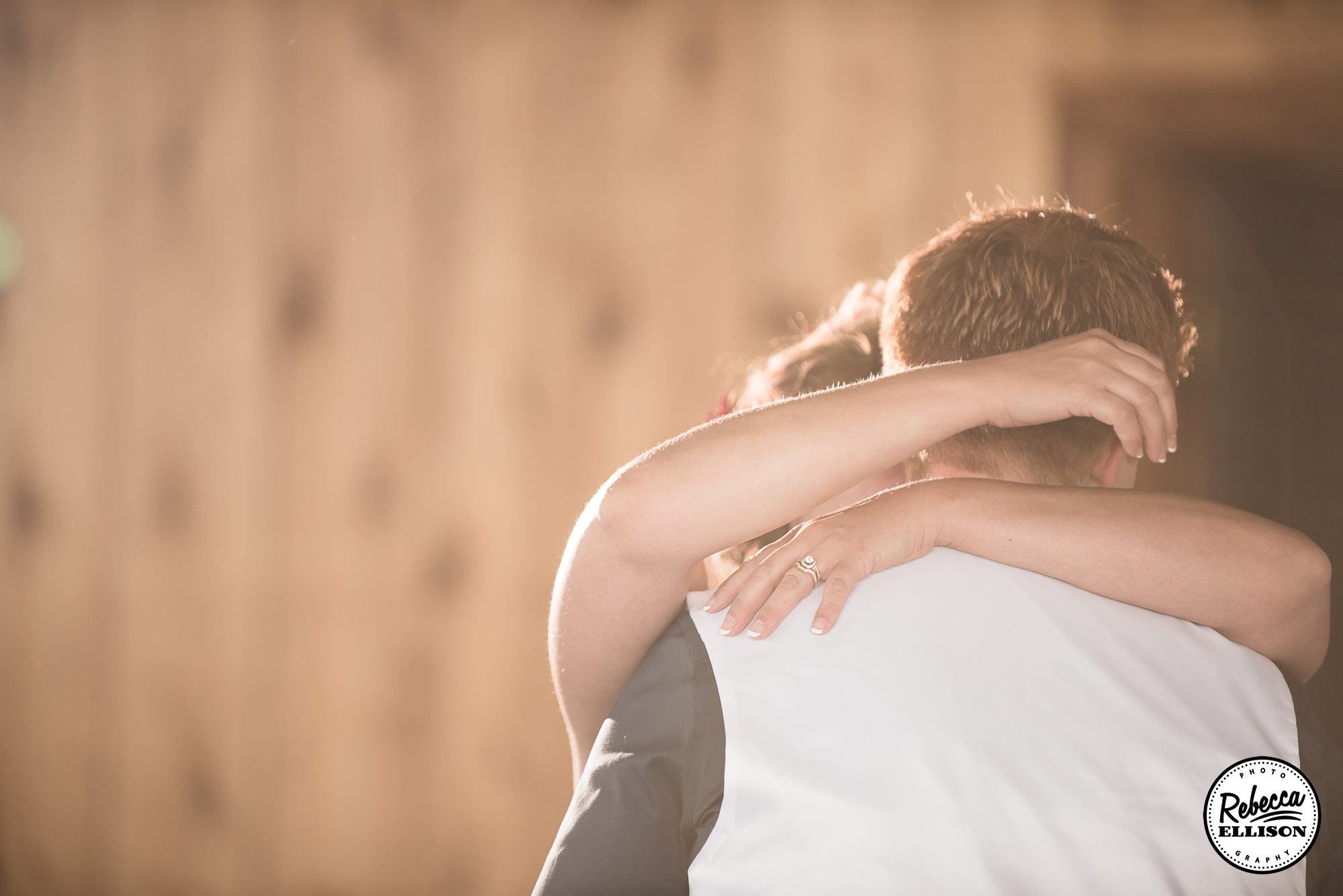 Dancing in the sunlight on their wedding day at the Hoodsport Beach Club photographed by Rebecca Ellison Photography