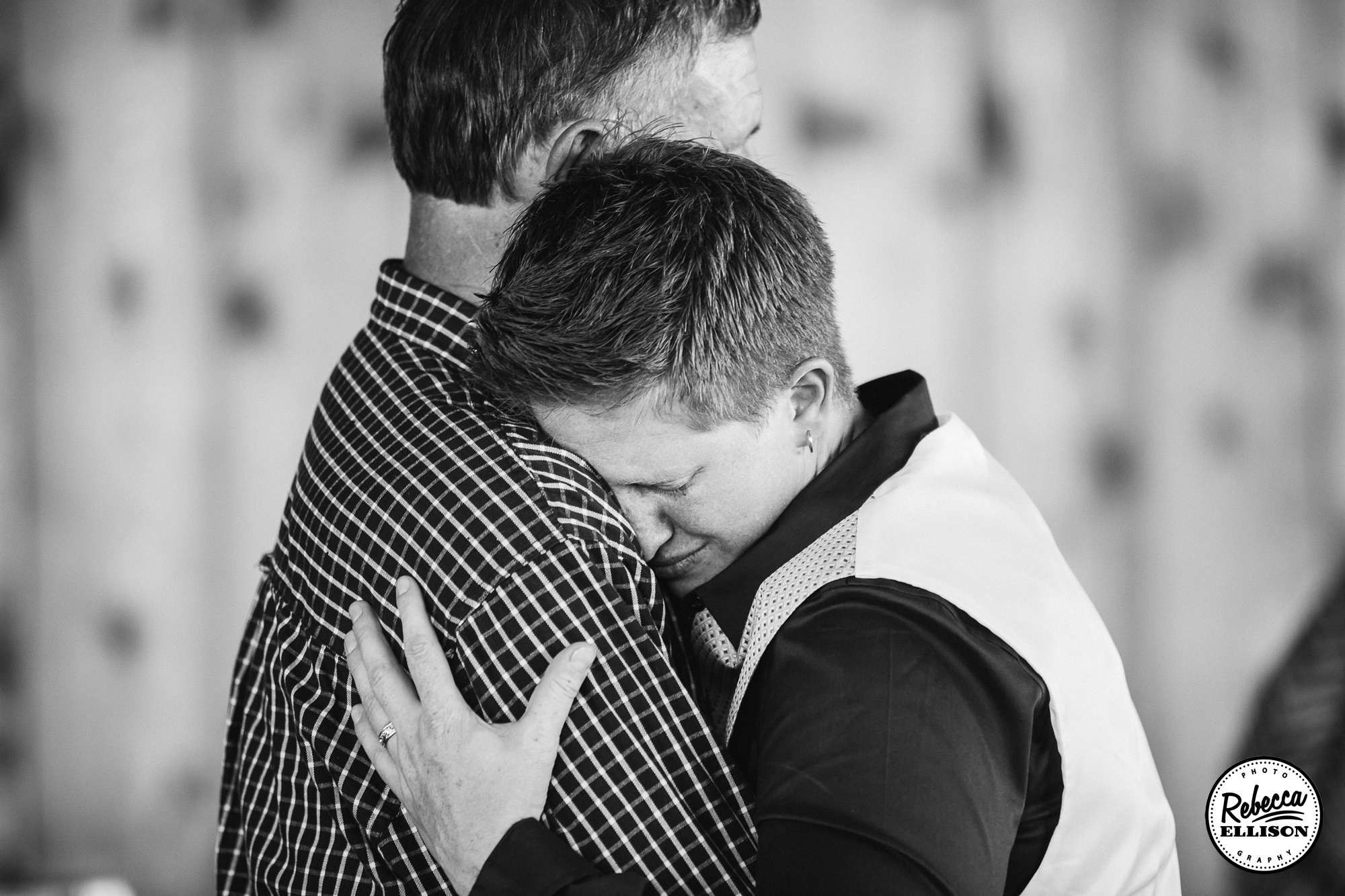Dancing with dad at a wedding reception a black and white portrait by Rebecca Ellison Photography