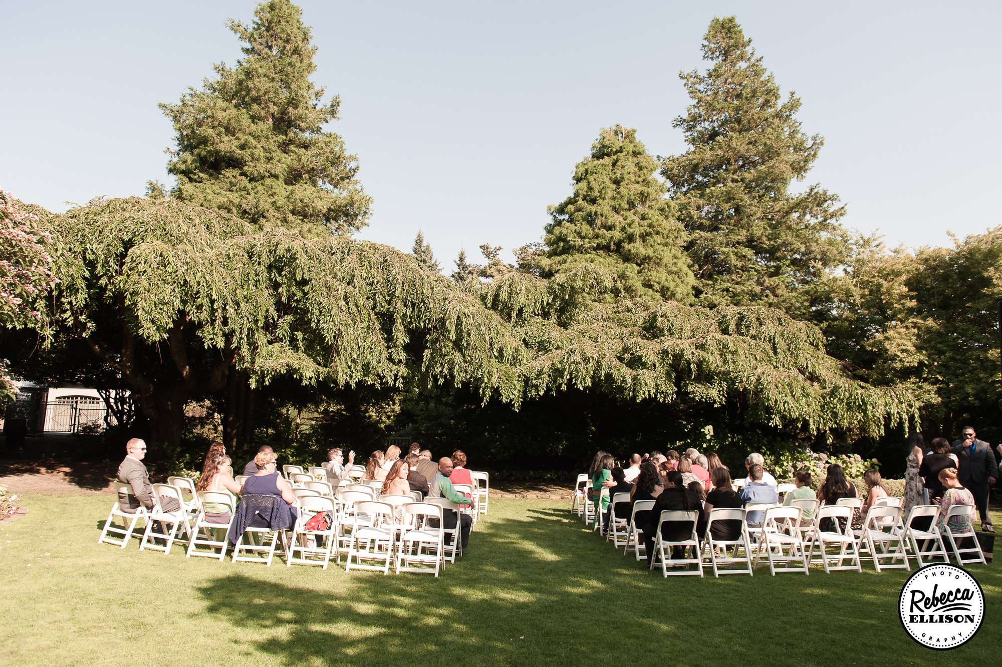 Wedding guests wait for the ceremony to start during a summer Seattle wedding at Parson Garden