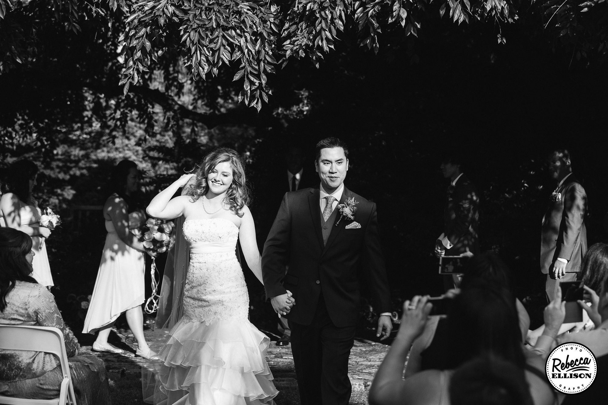 Bride and groom walk down the aisle after their summer Seattle wedding photographed by Rebecca Ellison Photography