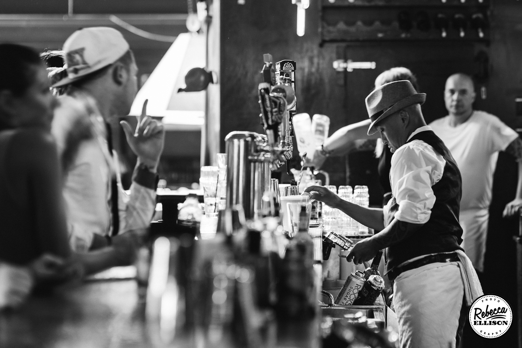 Bar service at The Ballroom in Seattle at a summer Seattle wedding photographed by Seattle wedding photographer Rebecca Ellison