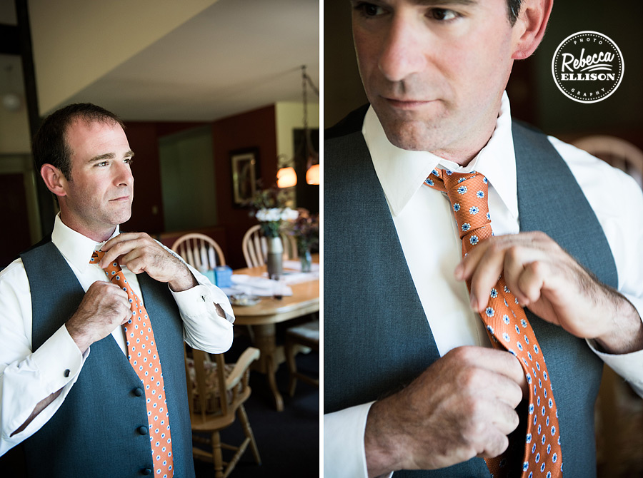 groom ties orange tie with blue circles on a grey suit at farm kitchen poulsbo photographed by Seattle wedding photographer Rebecca Ellison