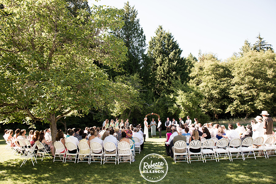 outdoor summer wedding ceremony on lawn at  farm kitchen wedding in poulsbo photographed by Seattle wedding photographer Rebecca Ellison