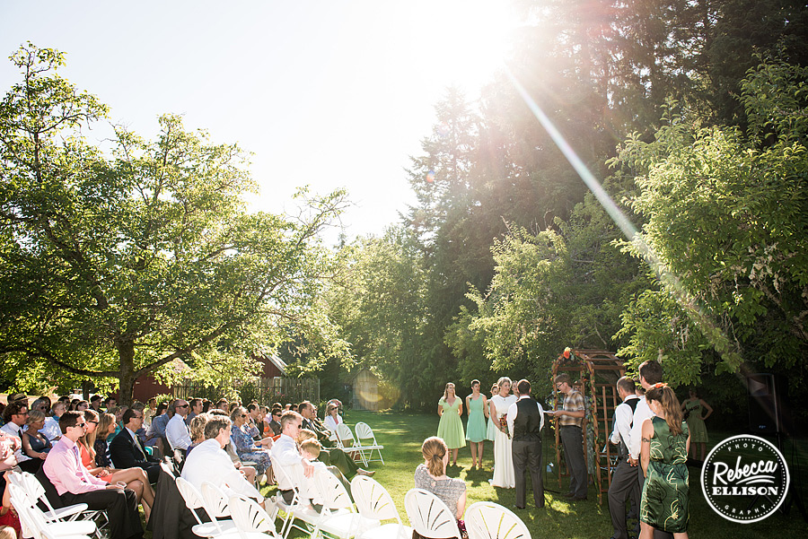late afternoon outdoor summer wedding ceremony on lawn at  farm kitchen wedding in poulsbo