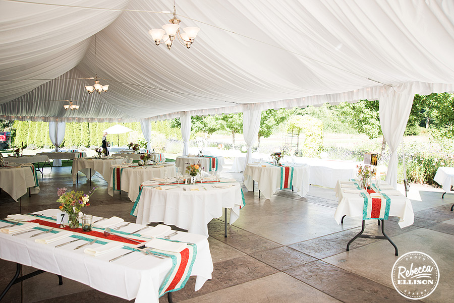 reception outdoor tent at  farm kitchen wedding in poulsbo photographed by Seattle wedding photographer Rebecca Ellison