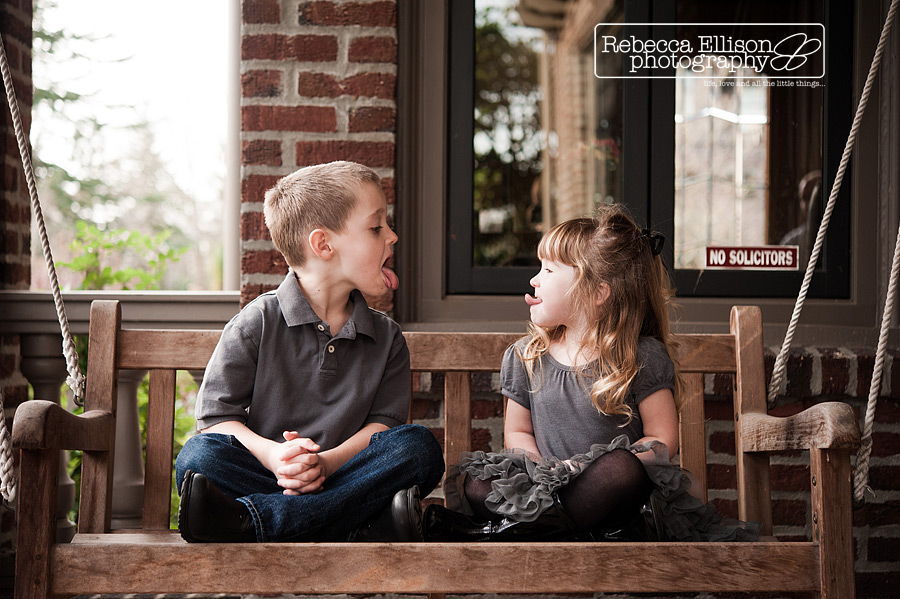 Brother and sister make faces at each other on their front porch in these sibling portraits from Seattle family photographer Rebecca Ellison