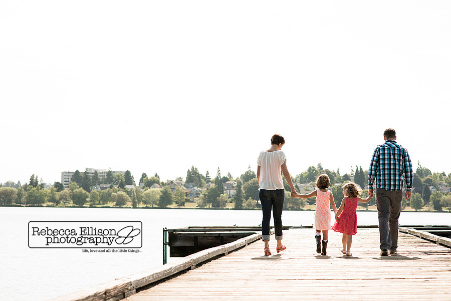 family walks down dock at greenlake family portraits session