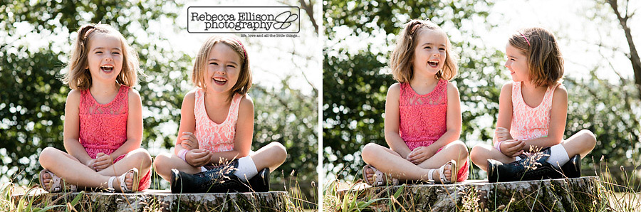 sisters laugh together while sitting on a tree stump during greenlake family portraits