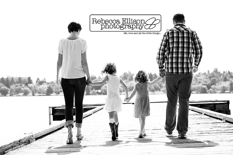 black and white image of family walking down a dock at greenlake family portraits by Rebecca Ellison Photography