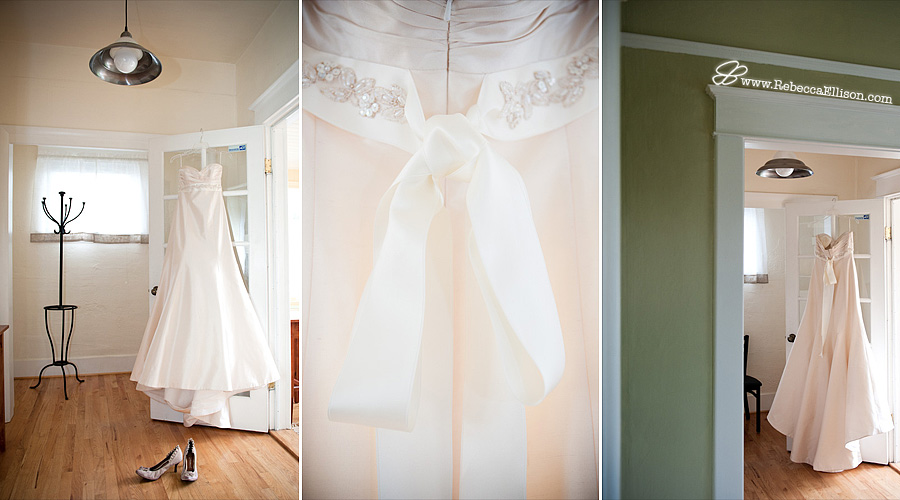 wedding dress by Romona Keveza Designer hangs in a doorway with bridal shoes in the foreground photographed by Seattle wedding photographer Rebecca Ellison